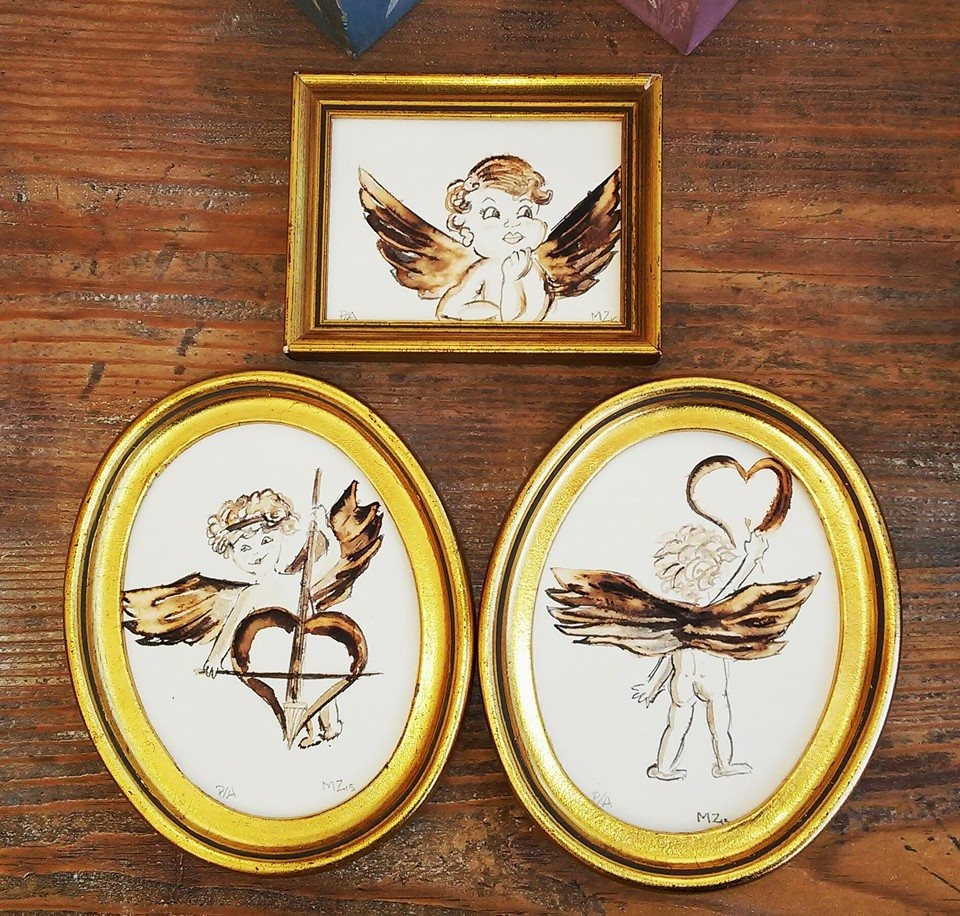 Angelitos en miniatura marco dorado